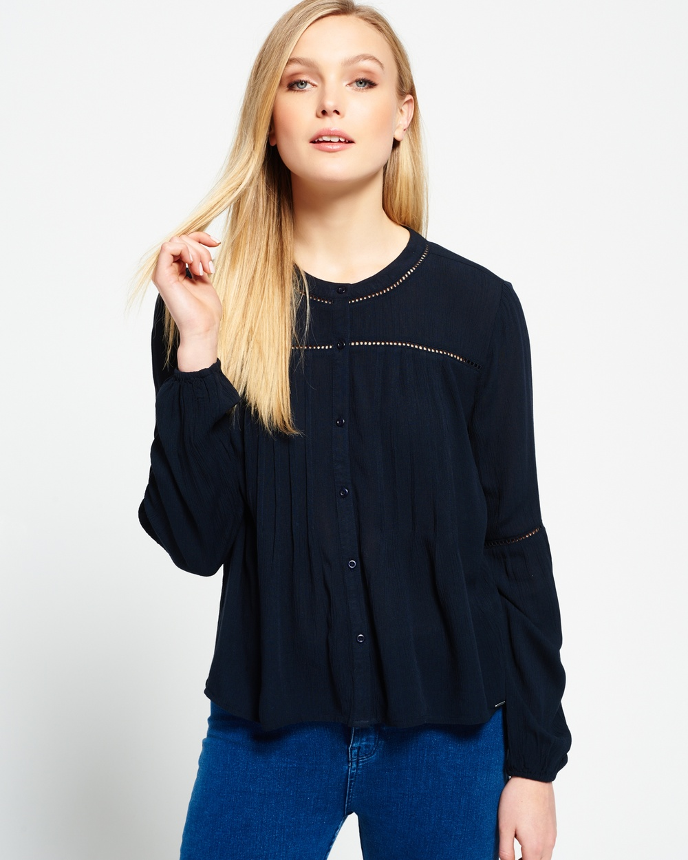 Photo of Superdry Superdry Maritime Ladder Blouse Tops Eclipse Navy Maritime Ladder Blouse - Superdry women's Maritime ladder blouse. This delicate long-sleeved blouse features a button down fastening, elasticated cuffs, lace ladder panels on the sleeves, collar and horizontal across the chest. The Maritime ladder blouse is finished with a subtle metal Superdry logo above the hem Model wears: Small Model height: 5'11
