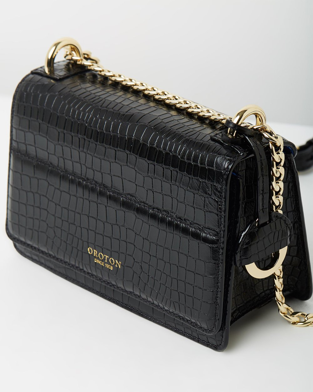 Forte Textured Mini Clutch by Oroton Online  4d8a49af49839