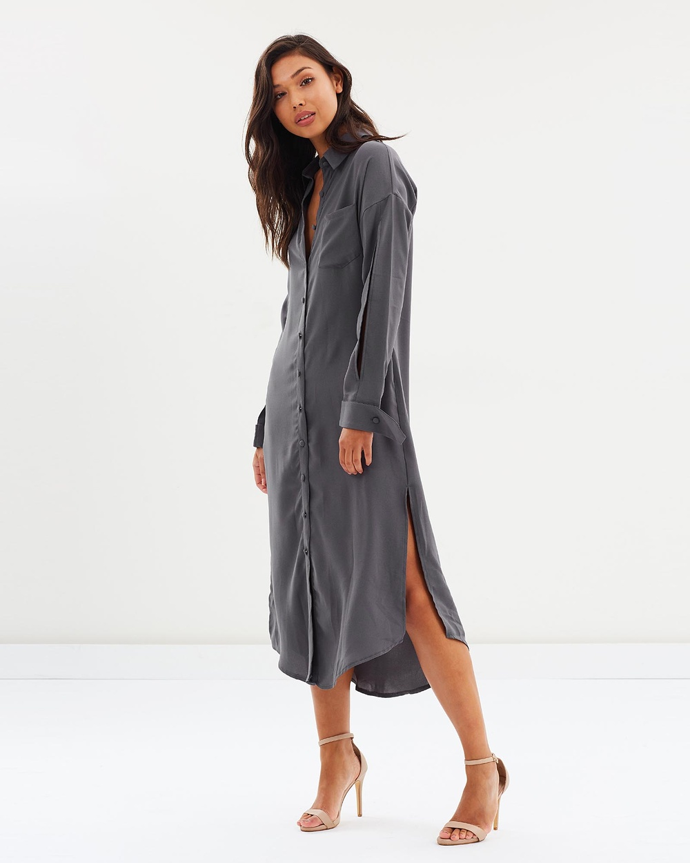Photo of DELPHINE DELPHINE Palladium Shirt Dress Dresses Charcoal Palladium Shirt Dress - The beautifully tailored Palladium Shirt Dress from Australian label DELPHINE is the perfect desk-to-dinner dress. This light charcoal dress is cut from a luxurious matte satin, it can be styled in a paired back way with simple flats and accessories for the office, then dressed-up with heels and a swipe of red lipstick when the sun goes down. Our model is wearing a size small dr