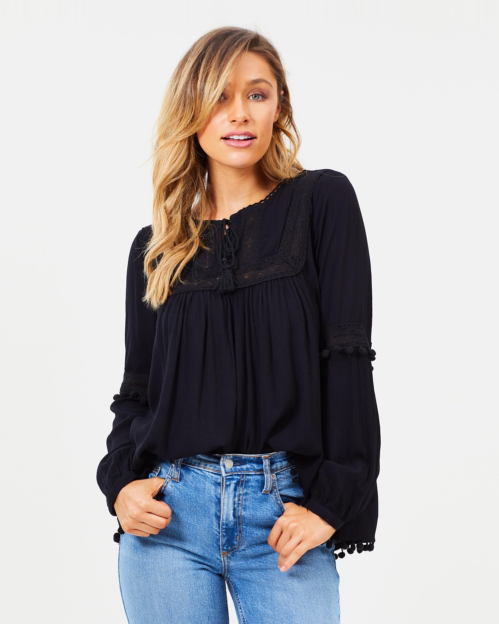 Photo of Sass Sass Free Spirit Pom Pom Blouse Tops Black Free Spirit Pom Pom Blouse - Dreamy and elegant, the Free Spirit Pom-Pom Blouse by Sass is stylish, elevated and sophisticated. With a lace-trimmed round neckline, blouson sleeves and playful pom-pom adornments, this blouse embraces one-of-a-kind minimalism with ease. Pair yours with some statement jewellery and a simple pair of straight-leg jeans for a put-together finish. Our model is wearing a size AU 8 blous
