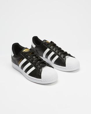 adidas Originals Superstar VEGAN   Unisex - Lifestyle Sneakers (Core Black, Footwear White & Gold Metallic)