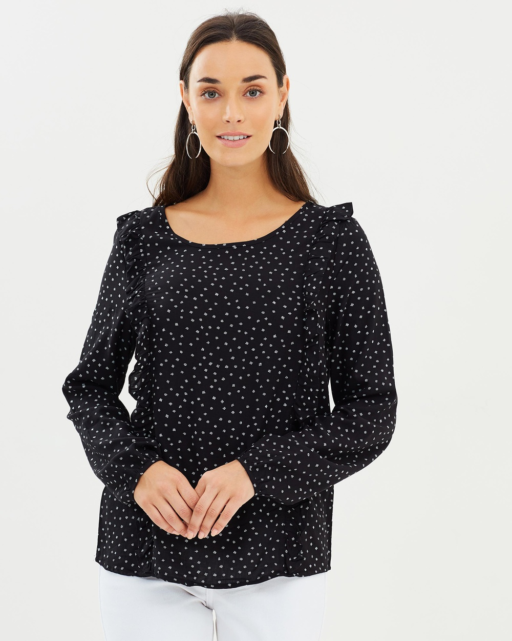 Photo of ONLY ONLY Nova Frill Top Tops Black & White Nova Frill Top - Silky smooth against the skin, the Nova Frill Top by ONLY is a staple long-sleeved shirt that's elevated by a charming dot print. Crafted from a tightly woven fabric, this top pairs seamlessly with cigarette pants and pencil skirts, making it an intelligent choice for the office. Our model is wearing a size UK 8 shirt. She is 170cm (5'7