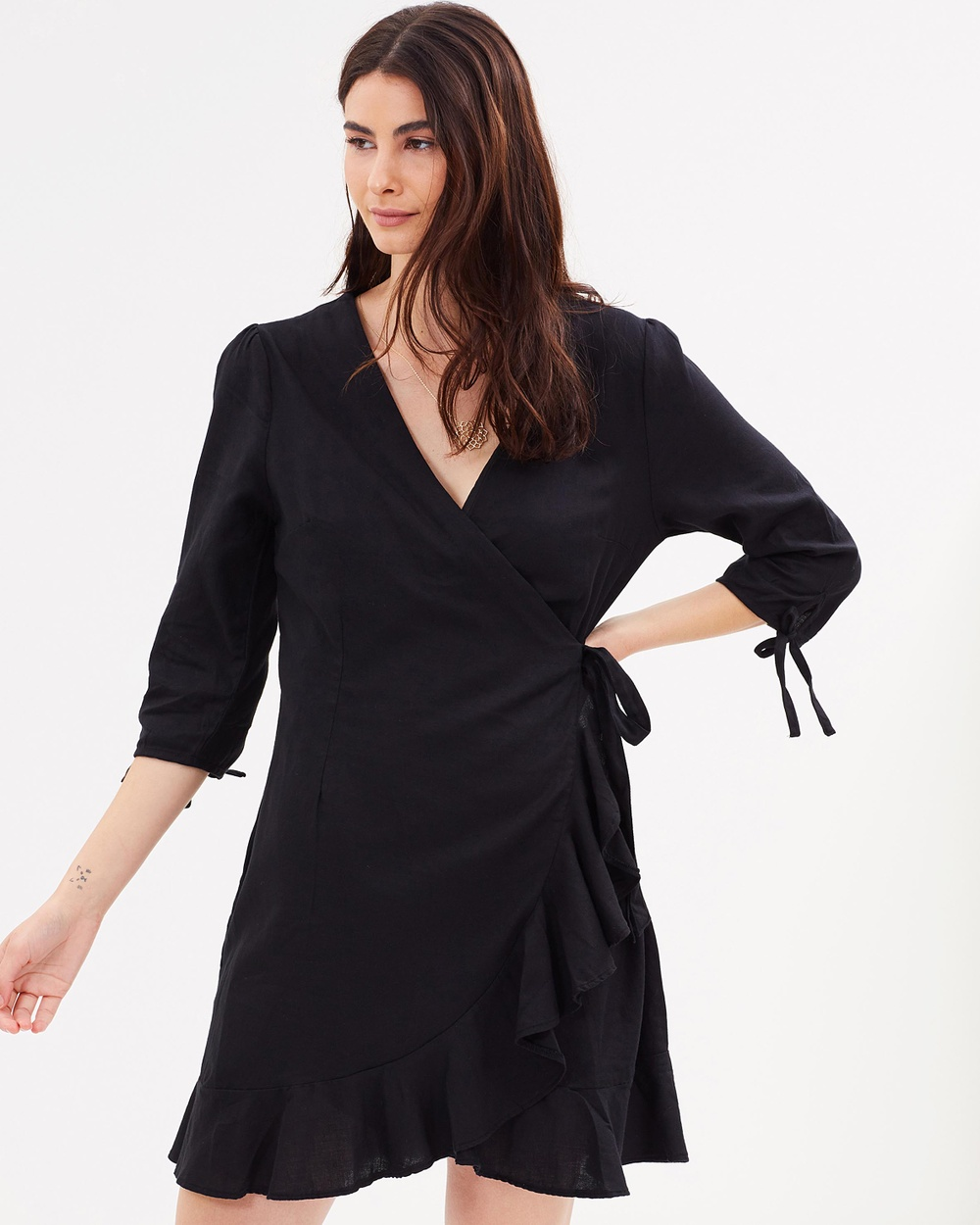 Photo of Cotton On Cotton On Woven Charli 3 4 Sleeve Wrap Dress Dresses Black Woven Charli 3-4 Sleeve Wrap Dress - From humble beginnings selling clothes out of the boot of a Ford Bronco in regional Australia to expanding into a globally recognised retailer, Cotton On are innovators in affordable ready-to-wear fashion. With a range of basic tees, pants, dresses and shorts they are a go-to brand for all your casual needs. The Woven Charli 3/4 Sleeve Wrap Dress in pure breathable co