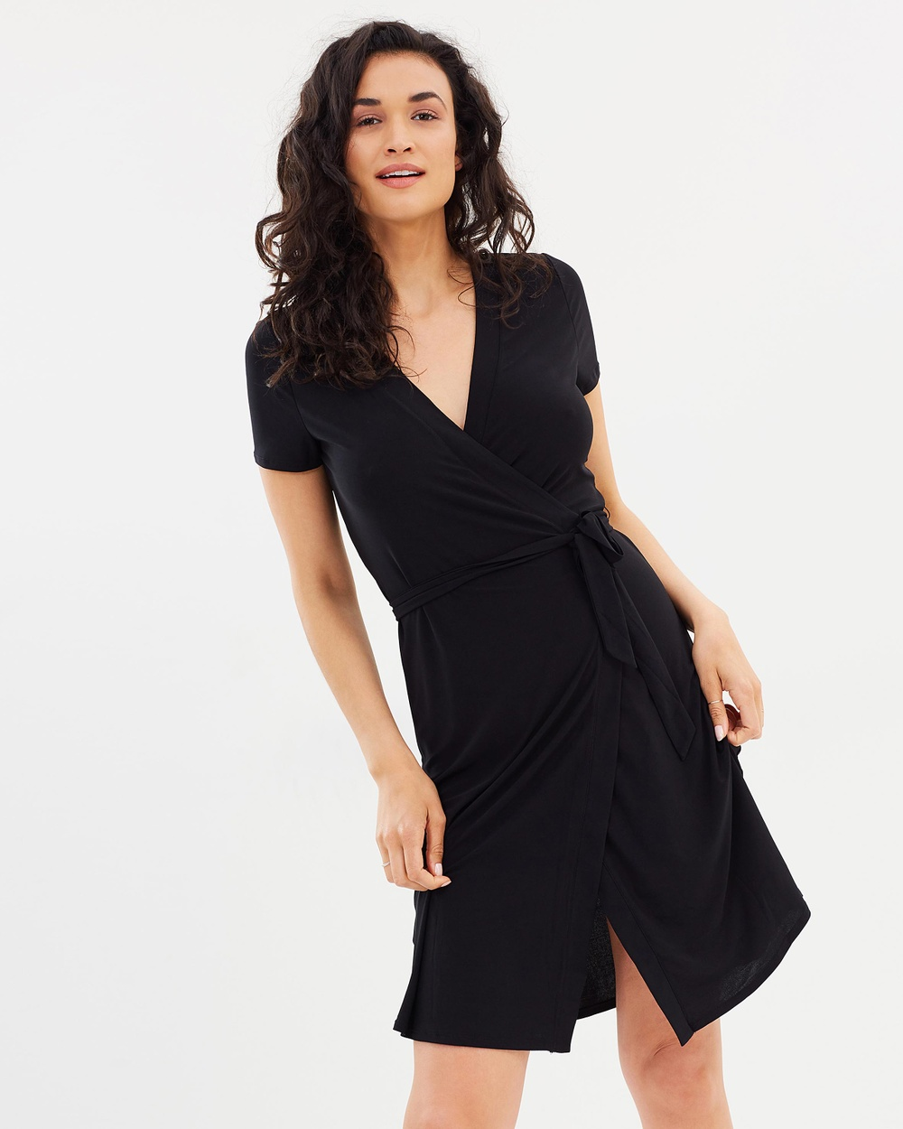 Photo of M.N.G M.N.G Bow Wrap Dress Dresses Black Bow Wrap Dress - Barcelona-born M.N.G dresses the modern woman with quality, chic designs that combine the best of this season's trends with timeless appeal. From trench coats to tailored blazers, relaxed knits, leather handbags, covetable shoes and glamorous maxi gowns, M.N.G delivers a range of designs to suit every style profile and dress code. Our model is wearing a size small dress. She is 178cm (5'10)