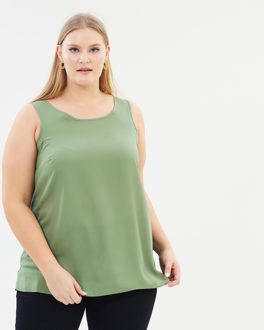 Photo of EVANS EVANS Built Up Vest Tops Light Green Built Up Vest - For fashion that flatters and celebrates your curves, look no further than EVANS. Coming in a clean black design with a round neckline, the Built Up Vest is sure to make a versatile addition to your wardrobe. Our model is wearing a size UK 18 top. She is 182.9cm (6'0