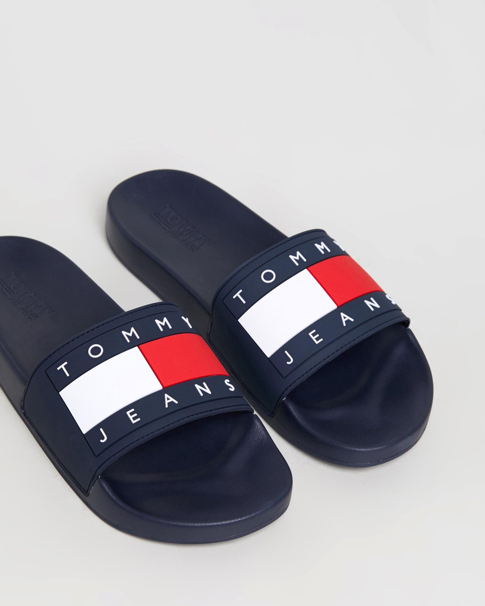 2e42de20c Flag Pool Slides by Tommy Jeans Online