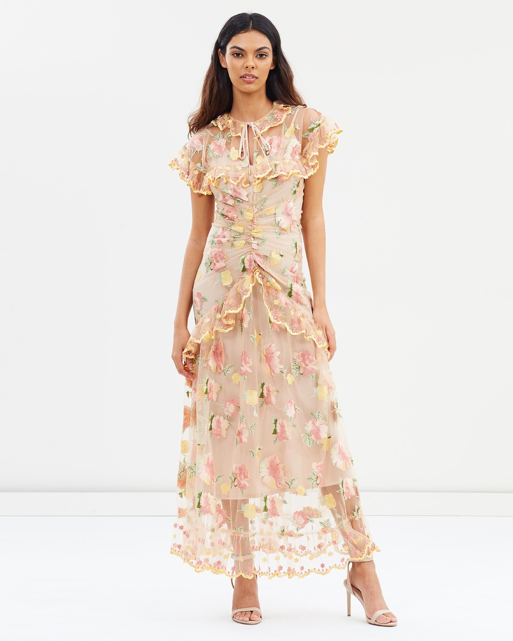 Photo of alice McCALL alice McCALL Floating Delicately Dress Dresses Nude Floating Delicately Dress - A diaphanous dream, the Floating Delicately Dress by Australian designer alice McCALL references a bucolic prairie-via-the-Victorian era mood with its high collared neckline and sheer frilled yoke. We adore the meandering floral embroidery and stunning attention to detail with the gold-toned metallic aglets to the charming neck-ties. Our model is wearing a size AU 8 dress. S