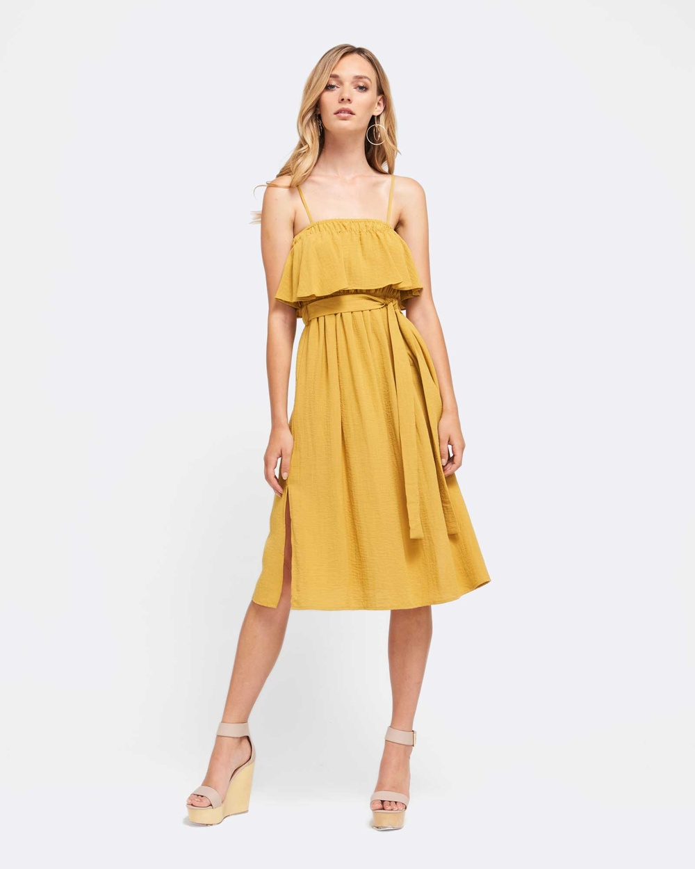 Photo of MVN MVN Sunset Lover Dress Dresses Mustard Sunset Lover Dress - Make an entrance with this MVN Sunset Lover dress. This mustard stunner comes with an elasticated ruffled neckline and cinched tie around the waist to create the perfect silhouette. With adjustable straps and slits on the sides of the dress, it's definitely a key must have for the summer. Our model is wearing a size 8 dress. She usually takes a standard AU 8 size, is 5'11 (180cm) and has