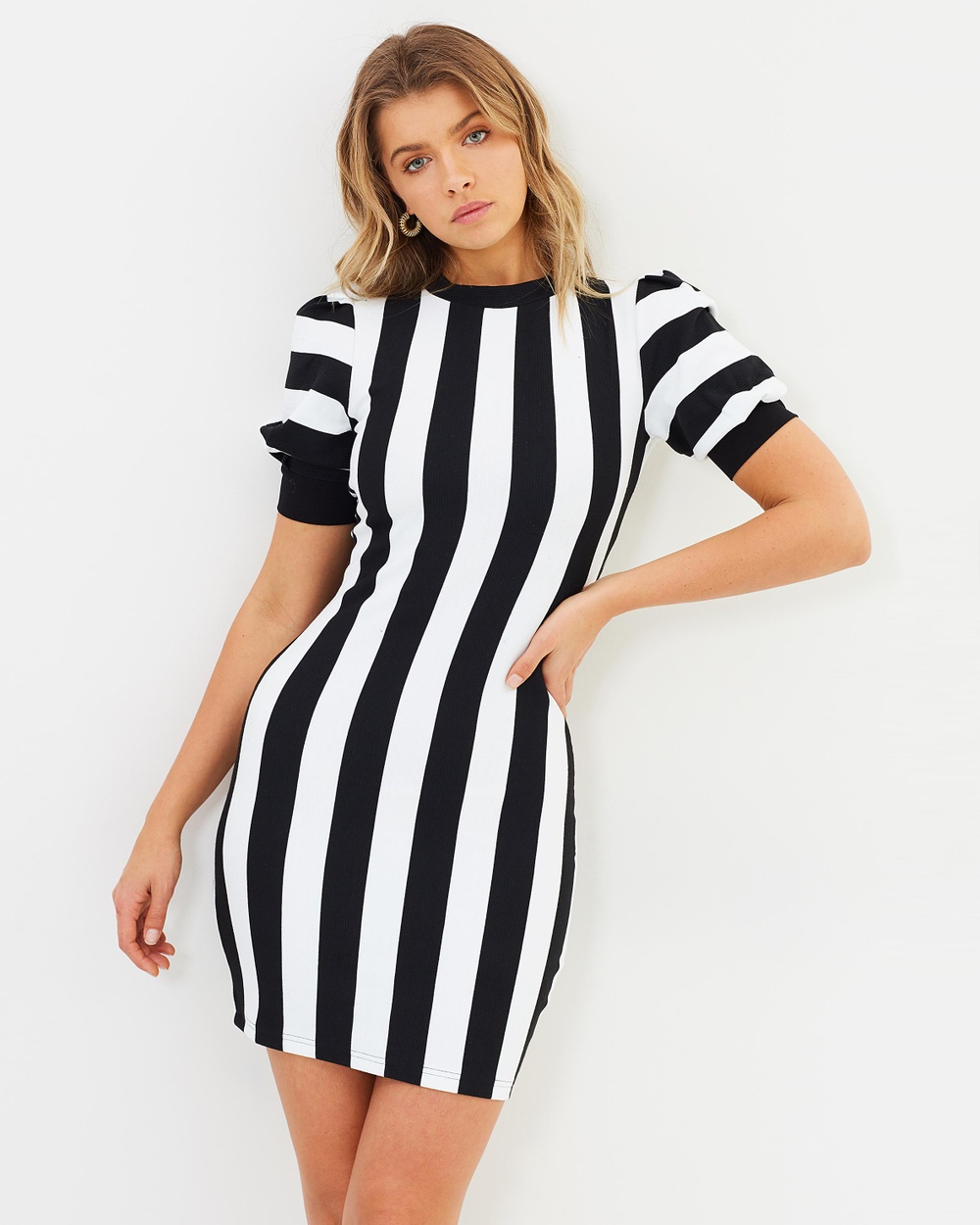 Photo of Atmos & Here Atmos & Here ICONIC EXCLUSIVE Sally Mini Dress Bodycon Dresses Stripe ICONIC EXCLUSIVE Sally Mini Dress - Cut to cling to your silhouette, the AtmosandHere Sally Mini Dress elevates the jersey t-shirt dress to evening status. It's rendered in black and white stripes and features feminine puff sleeves and a high neckline. Our model is wearing a size 8 dress. She is 181cm (5'11