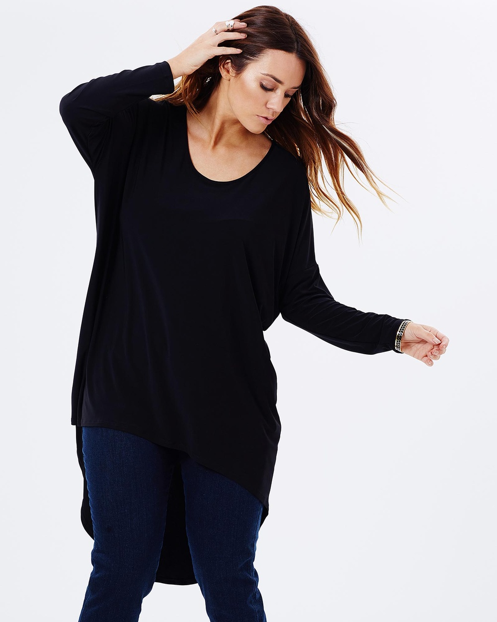 Photo of Harlow Harlow Diva Oversized Top Tops Black Diva Oversized Top - Fashioning a versatile black shade, the Harlow Diva Oversized Top has a relaxed design with full coverage. Wear yours with all your favourite separates. Our model is wearing a size extra small dress. She is a size AU14, and is 5'10 (177cm) tall. - Length: Front: 75cm Back: 110cm - Relaxed fit - Stretch-polyester lightweight jersey - Black shade - Round neckline - 3/4 sleeves - Dipped hemli