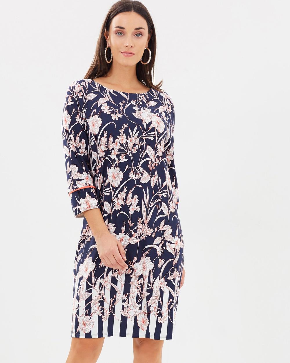 Photo of Wallis Wallis Stripe Border Floral Tunic Printed Dresses Navy Blue Stripe Border Floral Tunic - For on-trend womenswear with a classic twist, look to British fashion label Wallis. The Wallis woman is confident, fashionable and thoughtful in her approach to personal style. The label creates clothing to match a modern, 24/7 lifestyle, with feminine, chic designs that can take you from office to evening and weekend with ease. Our model is wearing a size UK 8 dress