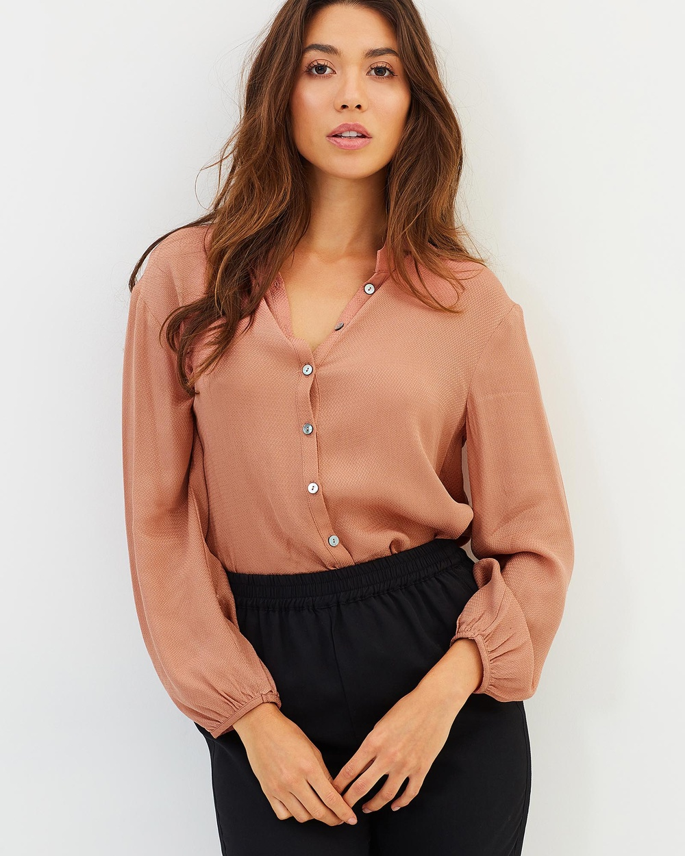 Photo of Privilege Privilege Ever After Swing Blouse Tops Soft Pink Ever After Swing Blouse - Striking the perfect balance between playful and professional, Privilege design flattering separates that boast fashion-forward flourishes that set them apart from the rest. Their Ever After Swing Blouse blends a traditional button-down with more whimsical details like blouson sleeves and relaxed, drapey silhouette. We love this blouse partially unbutton with a lace camisole pe
