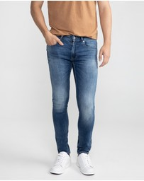 yd. - Roth Slim Tapered Jeans