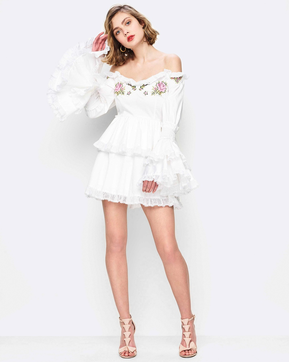 Photo of alice McCALL alice McCALL Valli Dress Dresses White Valli Dress - alice McCALL's Valli Dress is the epitome of feminine chic. Cut from a crisp cotton this baby doll mini dress flaunts coloured embroidery across the bust and upper sleeve. With a sweet heart off the shoulder neckline, this style has long sleeves that flare from the elbow and are finished with a girly lace trim. Our model is a size AU 8. She usually takes a size 8/S and is 177cm tall, has