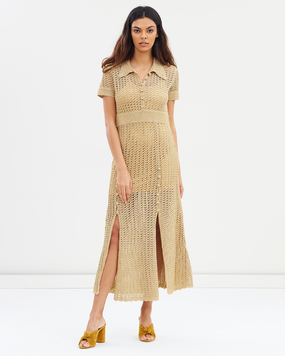 Photo of alice McCALL alice McCALL Bijou Bijou Dress Dresses Gold Bijou Bijou Dress - Intricately crafted from a combination of hand- and machine-crocheted metallic gold knit, the Bijou Bijou Dress exemplifies alice McCALL's sense of modern whimsy. This midi-length silhouette is rendered in soft metallic gold and finished with a sportive polo collar for a shot of contrast. Our model is wearing a size AU 8 dress. She is 177.8cm (5'10