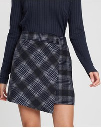 All About Eve - Patch Plaid Wrap Mini Skirt