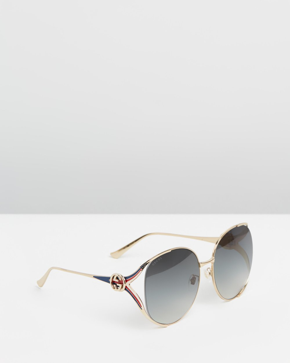 866c330ec40 Round Frame Metal Sunglasses by Gucci Online